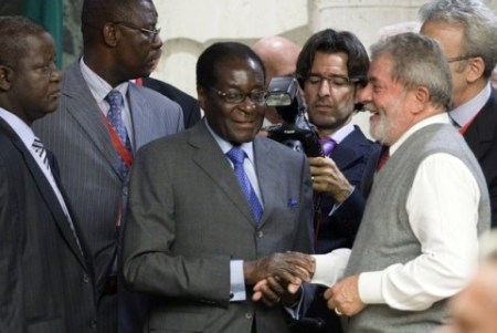 Brazil's President Lula da Silva greets Zimbabwe's President Mugabe during a food summit in Rome